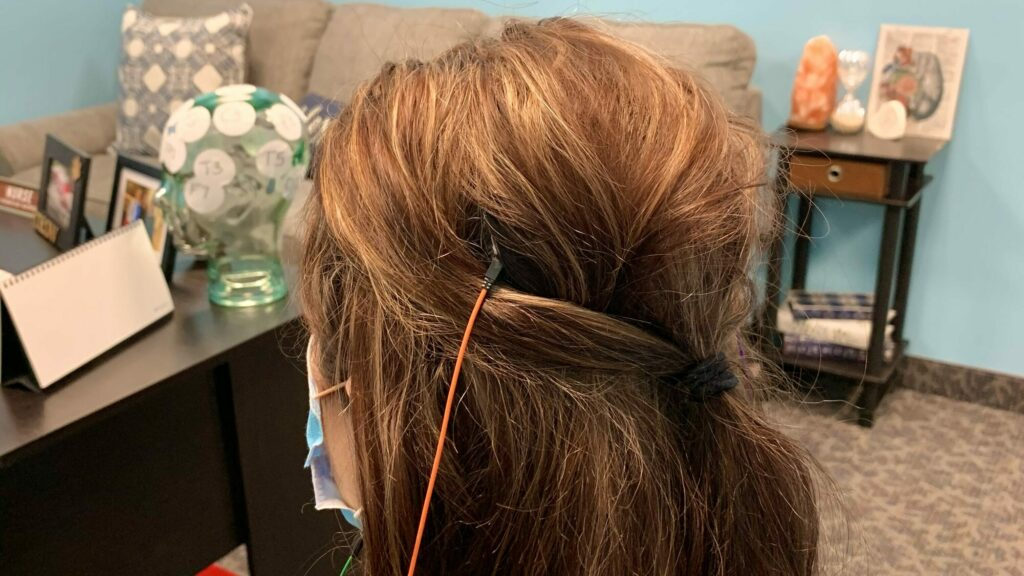 Female head with a Low Energy Neurofeedback Device